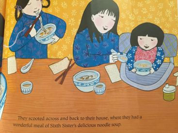 Looking at a page from The Seven Chinese Sisters, written by Kathy Tucker, Illustrated by Grace Lin. Albert Whitman & Co., c 2003.